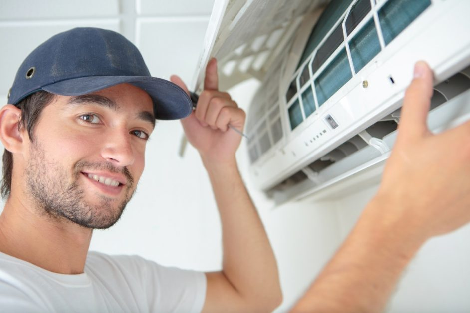 Technician fixing a ductless AC